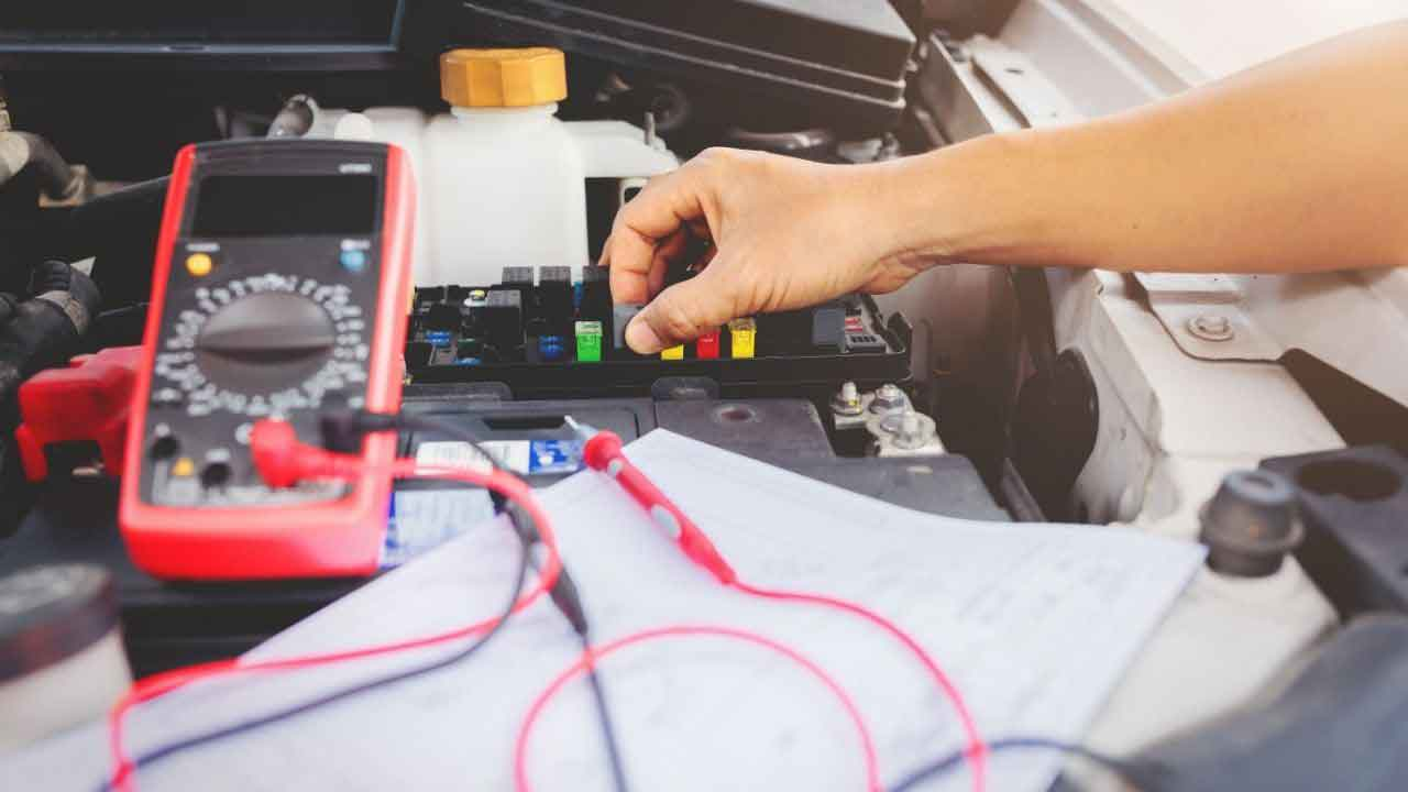 checking car with multimeter